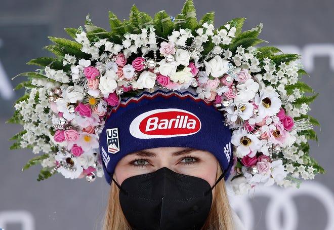 United States' Mikaela Shiffrin celebrates on the podium after winning an alpine ski, World Cup women's slalom in Jasna, Slovakia, Saturday, March 6, 2021.