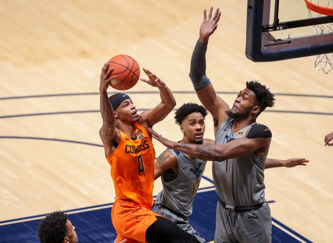 Cowboys guard Avery Anderson III scored a career-high 31 points as Oklahoma State upset West Virginia.