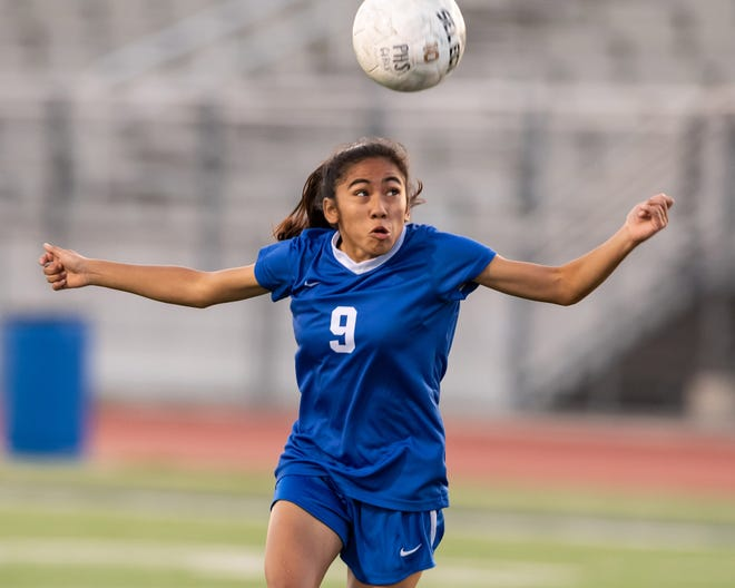 Pflugerville senior Isela Ramirez, heading the ball during a playoff game in her sophomore season, said her favorite vacation was a trip to Florida last summer. She aspires to play college soccer.