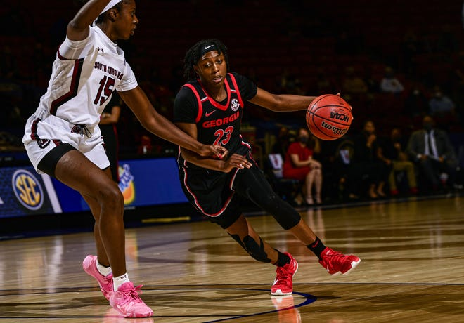 Georgia's Que Morrison (23) looks for a play while UCS's Laeticia Amihere (15) guards during the SEC Women's Basketball Tournament on Sunday, March 7, 2021 in Greenville.