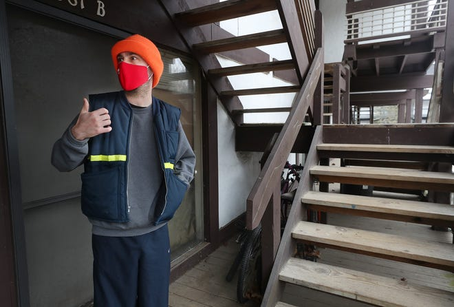 Tony Sullivan talks outside his apartment in the Timber Top complex in Akron on Jan. 31. Sullivan's rent has gone up from $485 to $600 in the five to six years he's lived there.