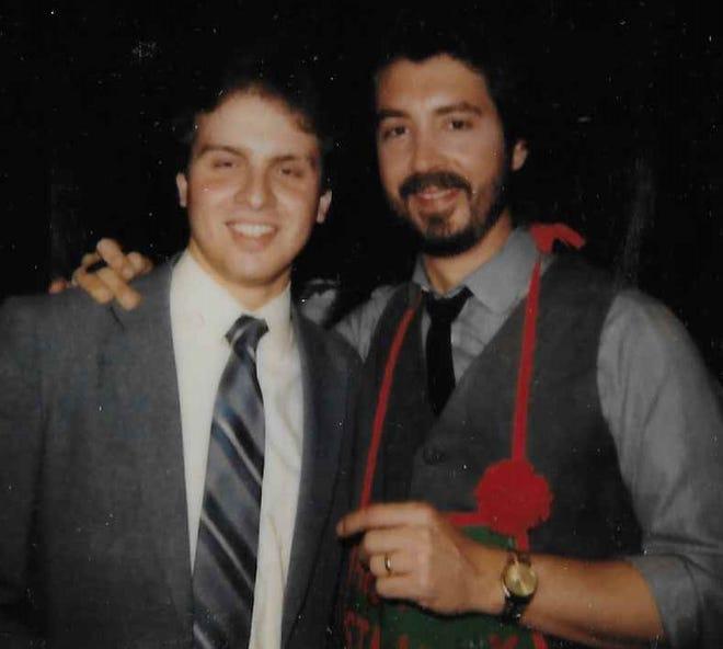 Richfield Coliseum intern Mark J. Price meets Ohio rock star Michael Stanley at a Cleveland luncheon circa 1984.