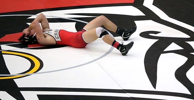 Chardon's Charlie Brosch reacts after losing to Field's Dallas Mcamis during their 182 pound consolation match in a Division II district wrestling tournament at Perry High School, Saturday, March 6, 2021, in Perry, Ohio. [Jeff Lange/Beacon Journal]