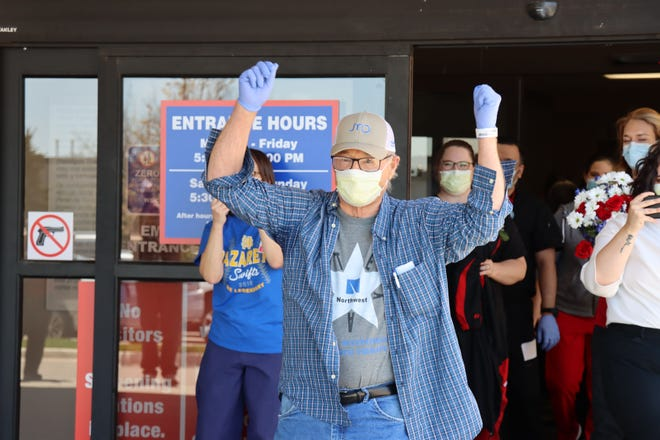 Ralph Albracht, 78, Nazareth, celebrates his recovery from COVID-19 on April 15 after being in Northwest Texas Hospital for nearly a month with the coronavirus.