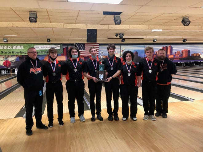 Ashland High bowling team members (from left) coach Mark Dreibelbis, Coen Zehner, Aiden Brown, Brysen Long, Avery Brown, Parker Grissinger, Zion Caudill and assistant coach Jimmy Brown pose for a picture after finishing second at the OHSAA Div. I Bowling State Tournament Saturday at Wayne Webb's Columbus Bowl.