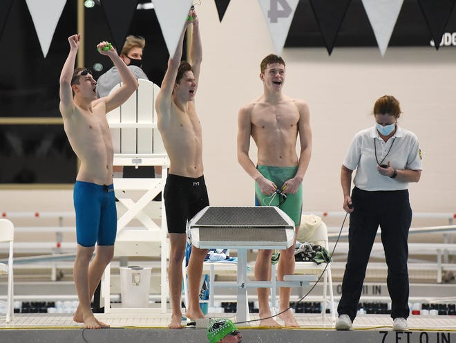 Riverside's Ryan Turner, Hayden Panek, Joe Roth and Alex Roth (in the pool) celebrate their first place win in the 400 freestyle relay during the WPIAL AA swimming championships Saturday at Upper St. Clair High School. Riverside placed 1st in the event.
