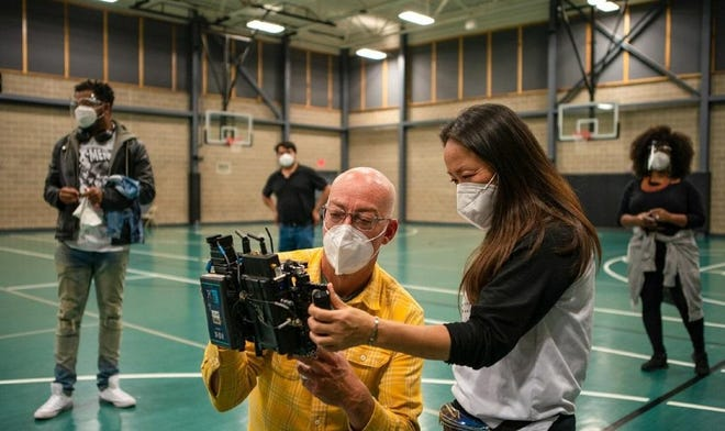 """OKC screenwriter, producer and director Lance McDaniel, left, and producer Hui Cha Poos work behind the scenes of their holiday movie """"Finding Carlos."""""""