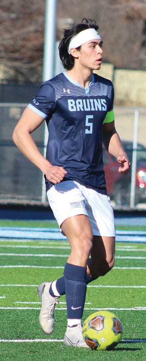 John Covell advances the ball for the Bartlesville High School boys' soccer team during fierce action last week.