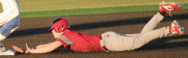 A Dewey High baserunner attempts to reach second base safely during varsity action last week.
