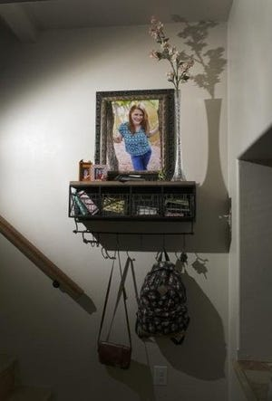 A photo of Jordan DeShazer and flowers from her funeral are displayed inside her parents home.