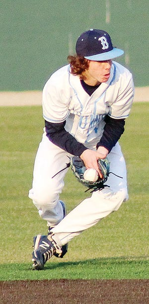 Bartlesville High second baseman Zeb Henry tries to get the handle on a grounder during Friday's home battle against Tahlequah High.