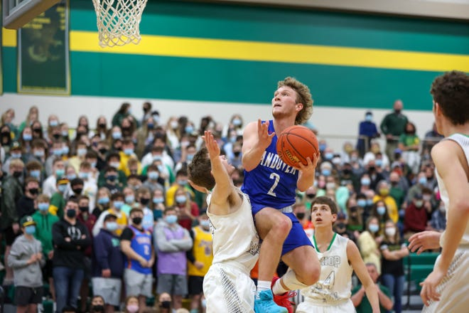 Andover's Jack Johnson goes up for a contested shot against a Bishop Carroll defender on Saturday, March 6 at Bishop Carroll High School. Johnson finished with six points in the game.