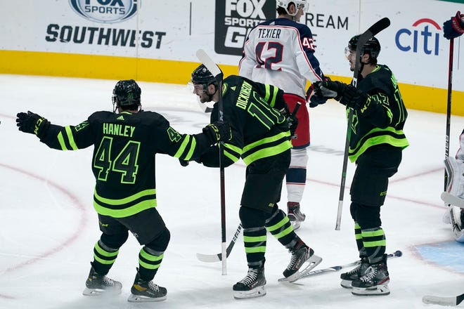 The Stars' Joel Hanley, left, Jason Dickinson, middle, and Nick Caamano celebrate Dickinson's first-period goal during the Blue Jackets' 5-0 loss Saturday in Dallas.