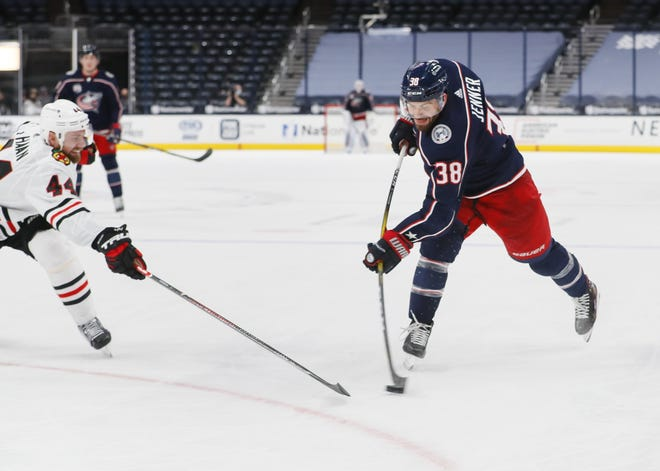 Blue Jackets center Boone Jenner, here shooting against Chicago on Feb. 25, ranks fourth in franchise history with 121 goals.