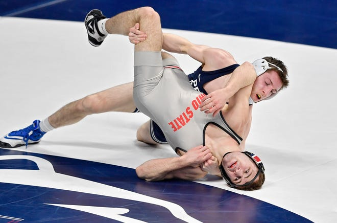 Ohio State's Dylan D'Emilio wrestles against Nick Lee of Penn State in a quarterfinal at 141 pounds in the Big Ten meet. Lee won by technical fall.