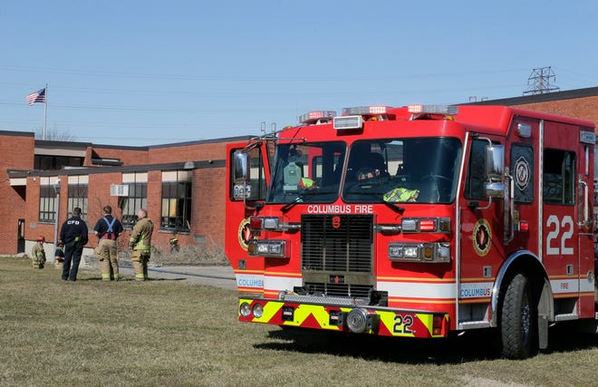 Firefighters from Columbus Divison of Fire's Station 22 investigate after extinguising a fire at Buckeye Middle School on Parsons A\ve on the south side of Columbus on March 7.