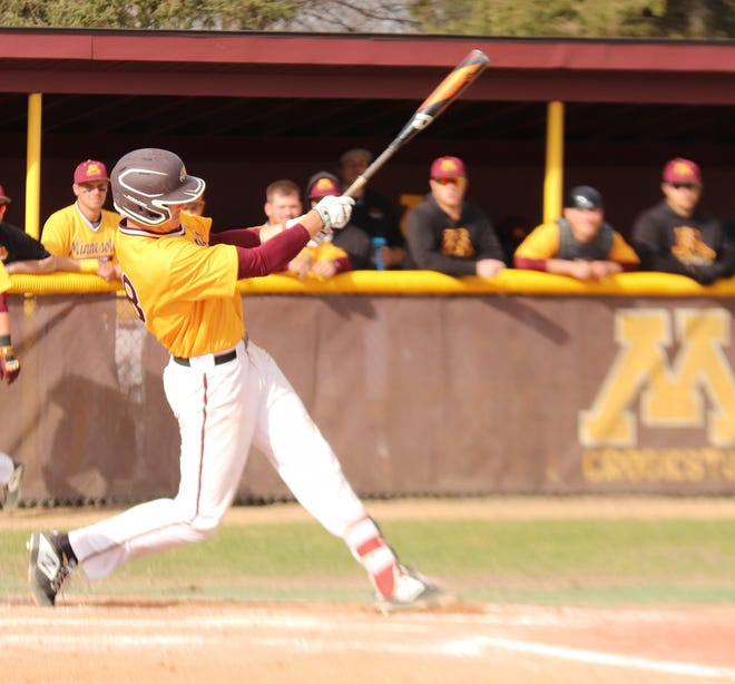 Scott Finberg takes a swing in a game against St. Cloud State in 2019. Finberg drove in three runs in Minnesota Crookston's season-opening, 23-6 rout of Bemidji State.