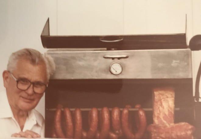 Charles Micka and sausage, circa 1970s