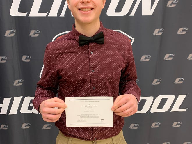 Josh Schaffner, a senior at Clinton High School, was recently named a finalist in the 2021 National Merit Scholarship Program. He poses for a photo with his certificate of being named a scholarship finalist.