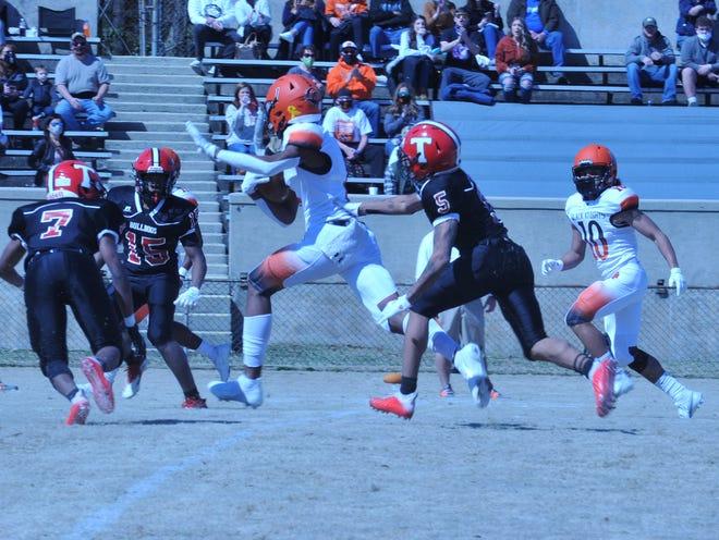 North Davidson's Jamarien Dalton heads down the field on a 47-yard reception against Thomasville. [Mike Duprez/The Dispatch]