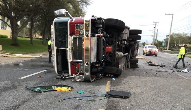 Daytona Beach police said this fire truck was flipped to its side after it was hit from behind by a Pontiac. The driver of the Pontiac, a 52-year-old woman from Ormond Beach, believed to have been traveling 80 mph, was killed.