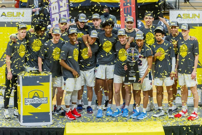 Liberty players celebrate winning the ASUN men's basketball title Sunday, after defeating North Alabama at UNF Arena in Jacksonville.