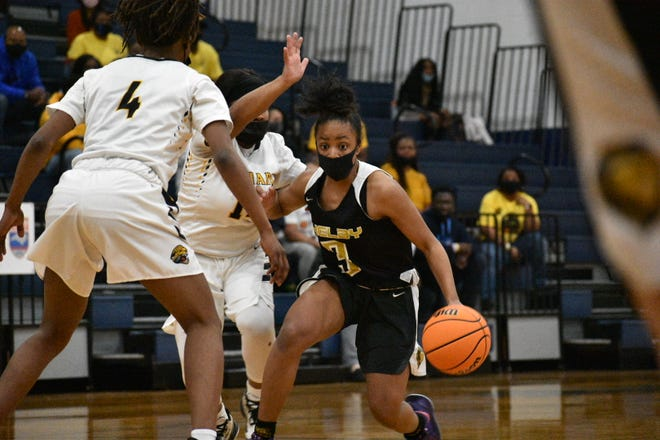 Shelby's Maraja Pass dribbles past a pair of Farmville Central defenders during the 2021 Class 2A girls basketball state championship game.