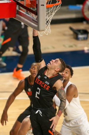 Mercer guard Neftali Alvarez (2), shown in an earlier game, converted a 3-point play in the final minute to give the Bears an upset win against Wofford on Saturday in the SoCon Tournament quarterfinals.