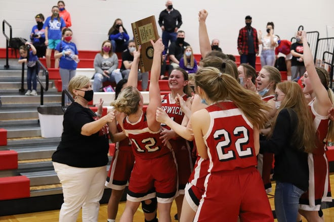 Norwich's Avery Rosenhagan hoists the title plaque in the Class 1A DI sub-state final Saturday afternoon.