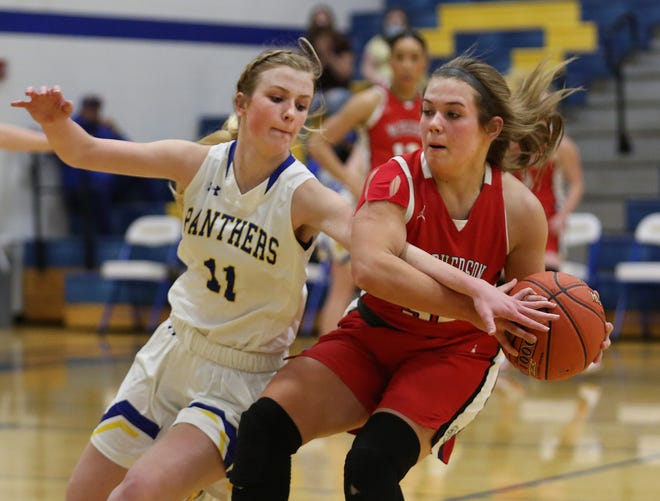 Nickerson's Kieryn Ontjes (11) reaches for the ball against McPherson's Emma Malm (32) during their Class 4A Sub-State championship game in Nickerson Saturday afternoon. McPherson defeated Nickerson 53-35.