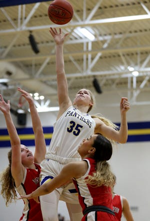 Nickerson's Ava Jones (35) shoots over McPherson's Grace Pyle (24) and Peyton Howard (12) during their Class 4A Sub-State championship game in Nickerson Saturday afternoon. Jones was the team's high scorer with 22 points. McPherson defeated Nickerson 53-35.
