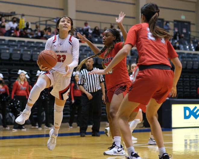 Lubbock-Cooper's Autumn Moore (23) runs around Legacy's Jazzy Owens-Barnett (30) for a layup during the Class 5A state semifinals on Saturday at St. Mary's University in San Antonio.