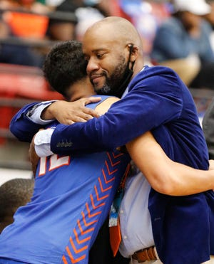 Bartow head coach Terrance McGriff hugs Alex Vigo during their state championship win earlier this year.