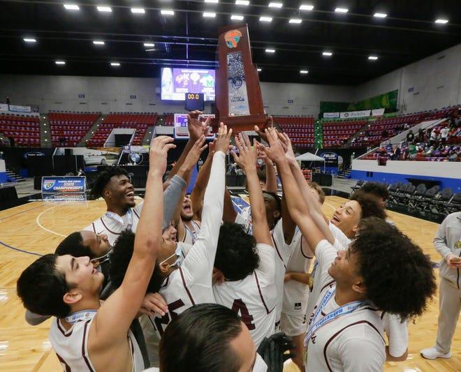 Pembroke Pines Jaguars  celebrate winning the Class 5A state title.