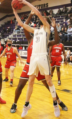 Cheraw High School's Trey Pearce goes up for a layup against Crowley County last Thursday at the Wolverines Den. The Wolverines defeated the Chargers 64-45.