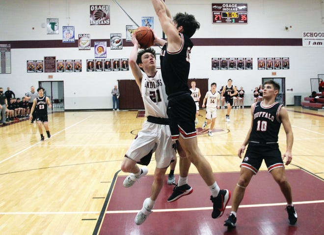 Osage junior Alton Drace goes up for a shot in the championship game of the Class 4 District 10 Tournament on Saturday, March 6, in Osage Beach. Drace and senior Quentin Britton led the Indians with 16 points each.
