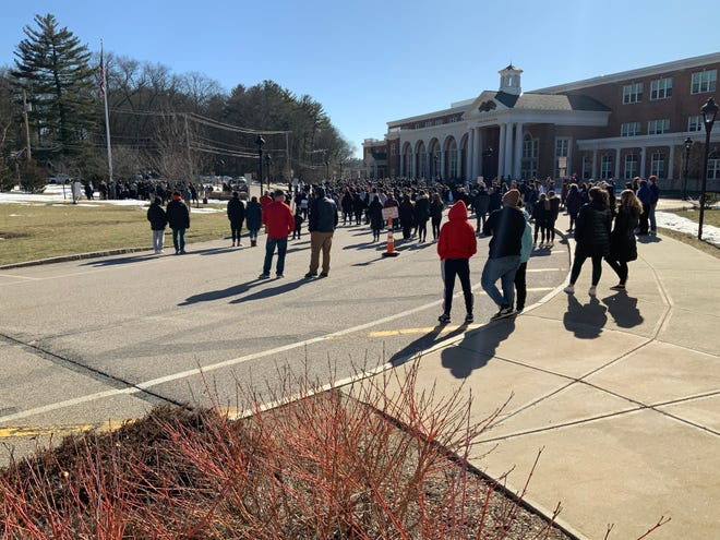 Hundreds gathered for a vigil at Natick High School on Sunday afternoon to honor the life of Giovanni Taboh, a 17-year-old Natick High junior who died in a car accident Saturday night on Interstate 93.