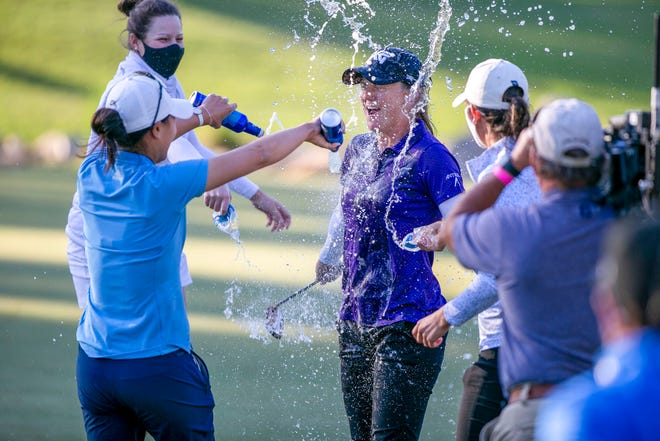 Austin Ernst gets a beer bath from fellow golfer Danielle Kang after winning the LPGA Drive On Championship at Golden Ocala on Sunday.