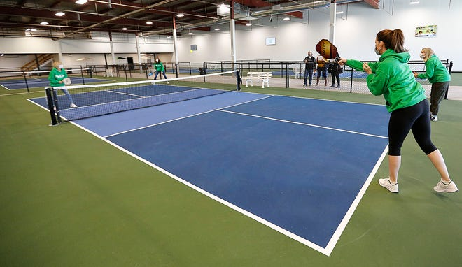 Staff members play pickleball at Pickles, a new indoor pickleball facility in Hanover on Sunday March 7, 2021.