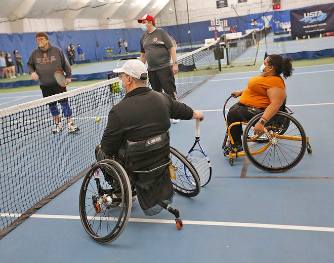 Members of the South Coast Wheelchair Tennis Foundation hold a clinic for new members at the South Shore YMCA in Hanover on Sunday, March 7, 2021.