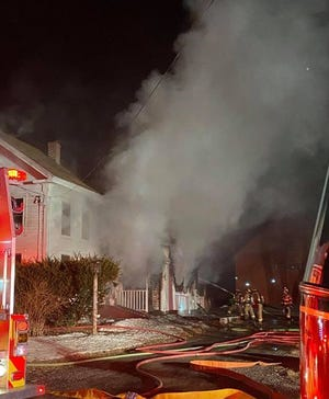 An Epping firefighter was injured as crews from multiple communities responded to a blaze at a home at 321 South Road in Brentwood Saturday, March 6, 2021.