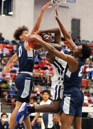 Dwyer's Rodrick Johnson Jr. is double-teamed by Dr. Phillips' Riley Kugel (11) and Ernest Udeh Jr. (21) during Saturday's Class 7A state championship game in Lakeland.