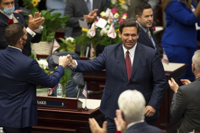 Gov. Ron DeSantis arrives in the House of Representatives chamber to give his State of the State speech on the first day of the 2021 Legislative Session in Tallahassee on March 2.