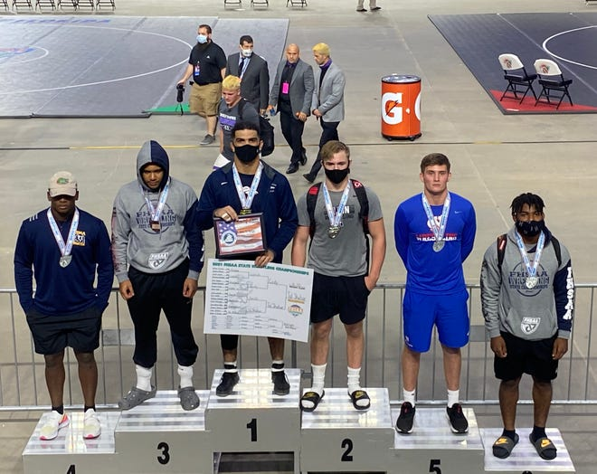 American Heritage's Mikey Tal Shahar, third from left, poses after winning the 195-pound wrestling state championship.