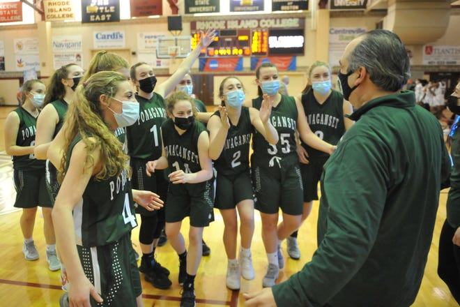 The Ponaganset girls basketball team celebrates with coach Gary Martinelli after the Chieftains beat Classical in triple overtime, 49-48, to claim the Division II title.