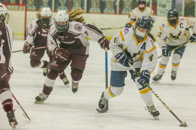 Marissa Levreault, a Portsmouth High student and member of the East Bay co-operative team, breaks down the ice during a game against La Salle.