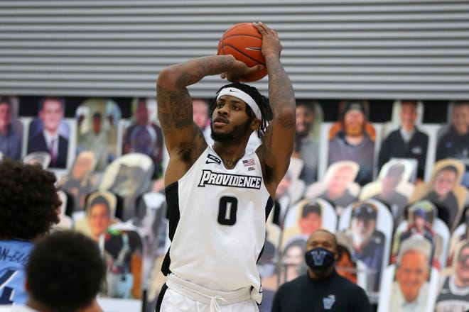 PC's Nate Watson scores on a 3-point shot during Saturday's game against Villanova, a 54-52 Friar victory. He tied for the team-lead with 20 points and will be hoping for another strong performance against DePaul on Wednesday night.