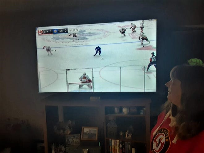 Stockton Heat supporter Kim Rede watches her team play on TV. The Heat has relocated to Canada for the season, but it hasn't diminished her enthusiasm for the Heat.