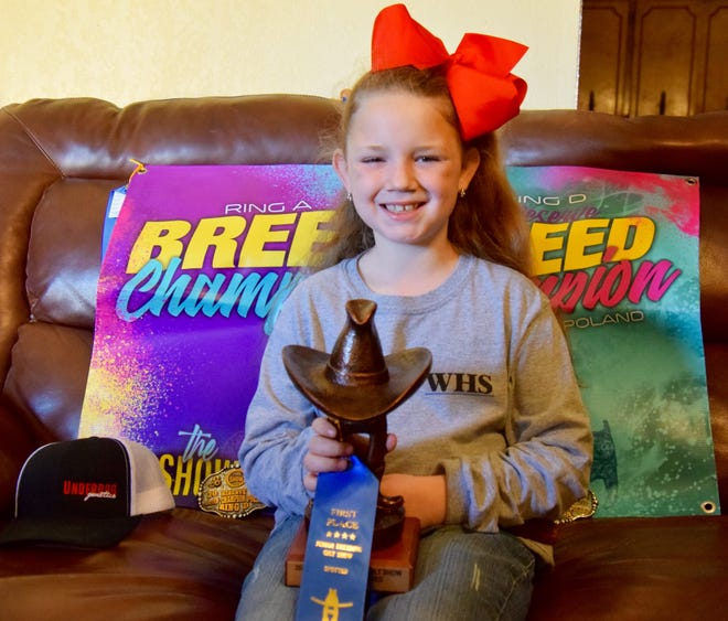 9-year old Karmen Miller has already earned some impressive awards from shows around the state. She has banners and buckles from numerous shows, as well as a trophy from the Houston Livestock Show & Rodeo.