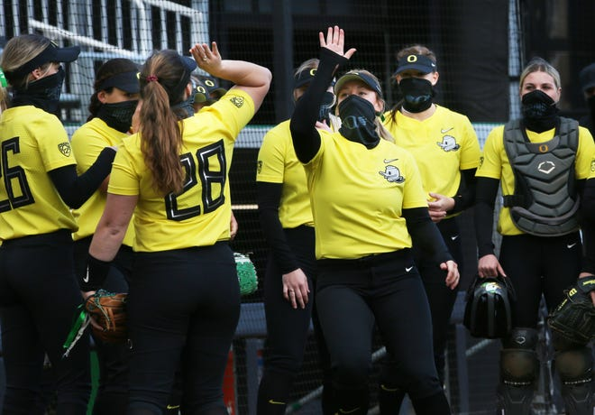 Oregon softball players take the field for their game against Portland State at Jane Sanders in Eugene March 6, 2021.